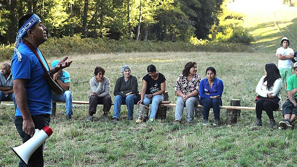 At far left is pictured is Alberto Curamil, 45, of Chile. Curamil, an indigenous Mapuche, stopped the development of two hydro-power plants in the Araucan'a region of Chile, protecting a critical ecosystem surrounding the Cautin River, which is considered sacred by his people.