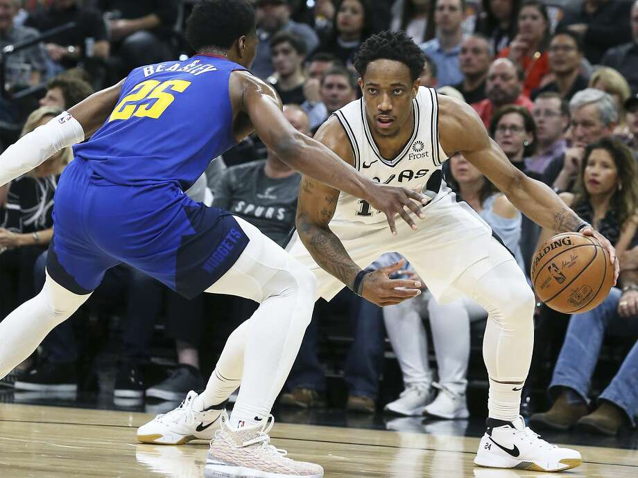DeMar DeRozan measures the flor against Malik Beasley as the Spurs host the Nuggets in game 6 of the first round of the Western Conference playoffs at the Alamodome on April 25, 2019. Photo: Tom Reel, Staff Photographer