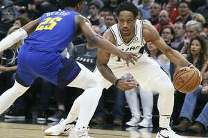 DeMar DeRozan measures the flor against Malik Beasley as the Spurs host the Nuggets in game 6 of the first round of the Western Conference playoffs at the Alamodome on April 25, 2019.