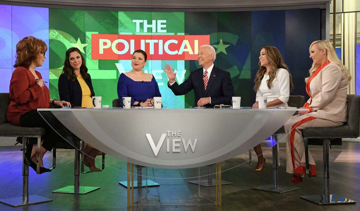 """This image released by ABC shows Democratic presidential candidate Joe Biden, third from right, with co-hosts, from left, Joy Behar, Abby Huntsman, Ana Navarro, Sunny Hostin and Meghan McCain during an appearance on """"The View,"""" Friday, April 26, 2019. (Lorenzo Bevilaqua/ABC via AP)"""