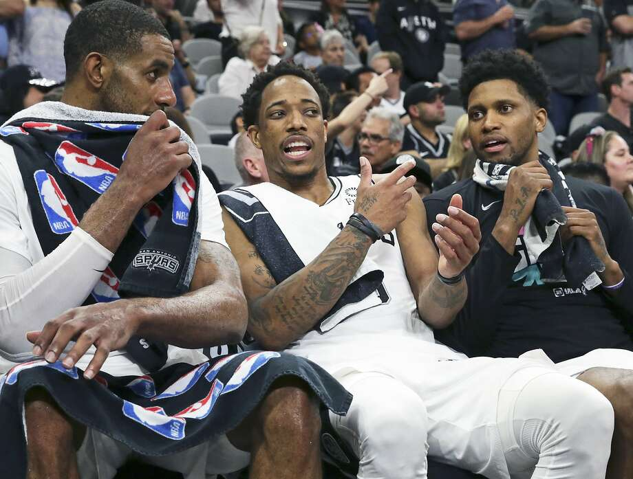 LaMarcus Aldridge, DeMar DeRozan and Rudy Gay chat after coming out of the game late as the Spurs host the Nuggets in game 6 of the first round of the Western Conference playoffs at the Alamodome on April 25, 2019. Photo: Tom Reel, Staff Photographer