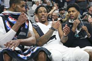 LaMarcus Aldridge, DeMar DeRozan and Rudy Gay chat after coming out of the game late as the Spurs host the Nuggets in game 6 of the first round of the Western Conference playoffs at the Alamodome on April 25, 2019.