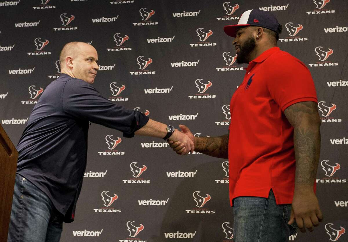 Houston Texans head coach Bill O'Brien, left, shakes hands with Texans top draft pick Tytus Howard during an introductory news conference at NRG Stadium on Friday, April 26, 2019, in Houston. Howard, an offensive lineman from Alabama State was the 23rd overall selection in the 2019 NFL Draft.
