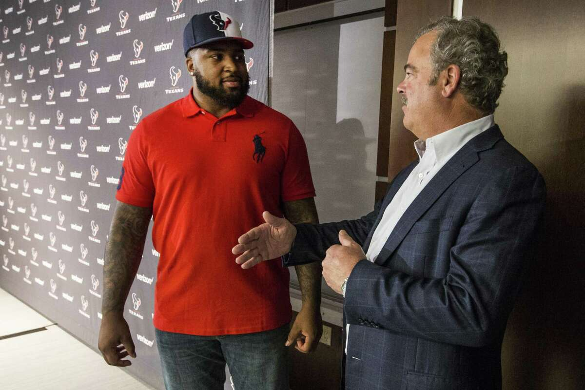 Houston Texans top draft pick Tytus Howard, left, talks to Texans chairman and CEO, following an introductory news conference at NRG Stadium on Friday, April 26, 2019, in Houston. Howard, an offensive lineman from Alabama State was the 23rd overall selection in the 2019 NFL Draft.