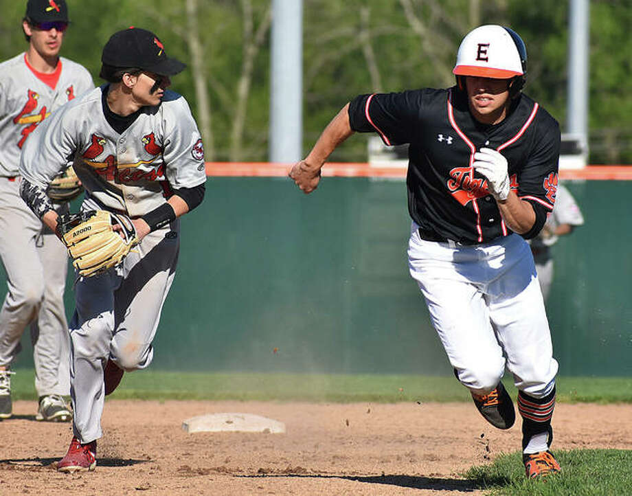 Alton's Dylan Lahue, left, chases Edwardsville's Joe Toscano during a pickle between second and third on Friday at Tom Pile Field in Edwardsville. Photo: Matt Kamp/The Intelligencer