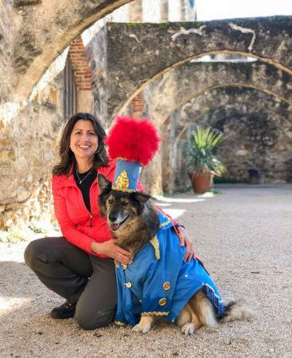 Norma Brooks, 53, is seen next to her therapy dog Shanti, who is this year's King Anbarkio XII, the grand marshal for Satruday's Fiesta Pooch Parade. Brooks died Friday, April 26, 2019, as a result of injuries she received from a car accident earlier this week, according to Therapy Animals of San Antonio.