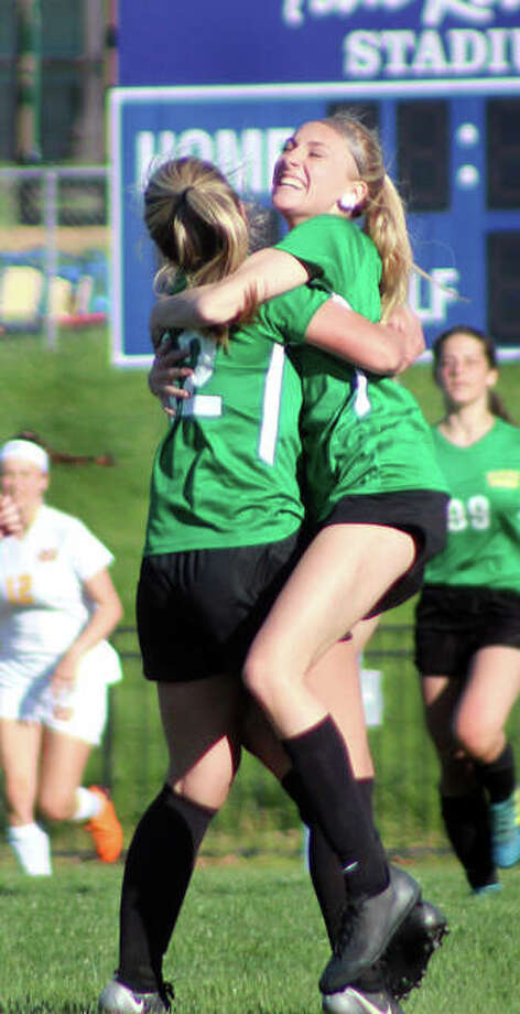 Southwestern's Zoe Swift, left, celebrates with teammate Morgan Durham after Swift scored a goal on a 30-yard direct free kick in the second half of Friday's game against Civic Memorial at LCCC's Tim Rooney Stadium. The teams battled to a 3-3 tie. Photo: Pete Hayes | The Telegraph