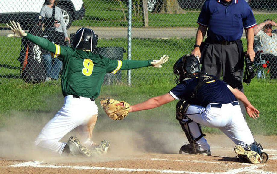 Metro-East Lutheran's Jonah Wilson, left, is safe at the plate on a sacrifice fly by Erik Broekemeier in the top of the fifth inning in Friday's game at MELHS as Father McGivney catcher Luke Deakos tries to make the tag.