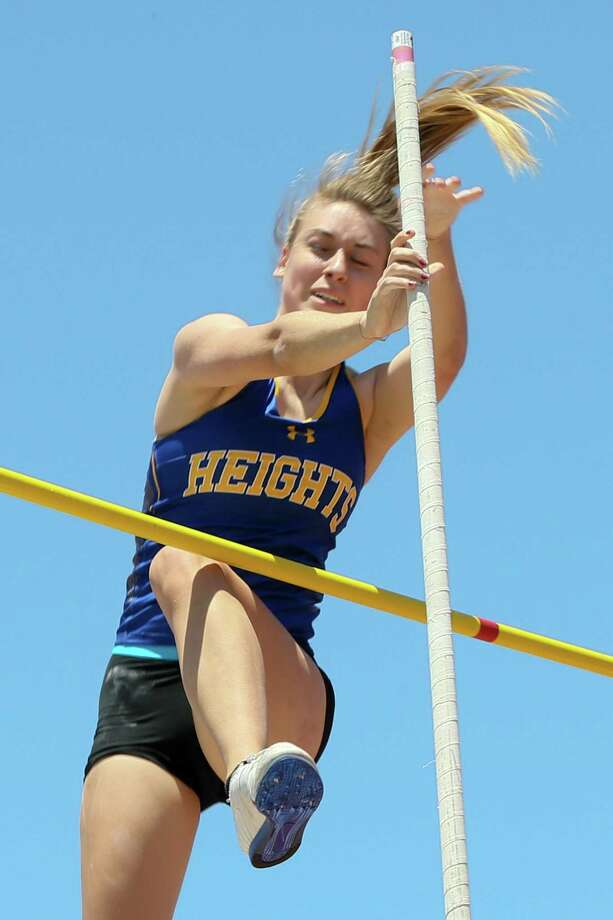 "Alamo Heights' Alina Borawski attempts to clear the bar at 11"" 0"" during the first day of the Region IV-5A track and field meet at Heroes Stadium on Friday, April 26, 2019. Borawski finished second in the event with a vault of 10'9"". Photo: Marvin Pfeiffer, Staff Photographer / Express-News 2019"
