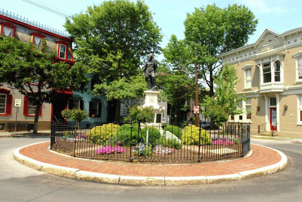 """Monday, July 7, 2008, Schenectady, NY, View of the Indian monument marking """"The New Queen's Fort"""" built in 1705 in the Stockade Section of Schenectady, NY. This view taken on Monday, July 7, 2008, showing some of the neighborhood architecture. The fortification was used for parades and drills and was taken down during the American Revolution, and replaced with barracks for the soldiers. Photos for story and promo for Times Union Feature Dept. Reporter, Tom Keyser's story, for the 2008 Edition of """"Where's Tom"""", contest."""