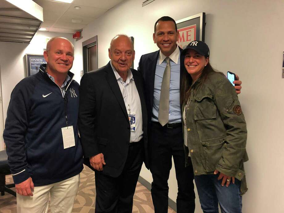 Greenwich residents Peter St. Phillip, the YES Network's John (Flip) Filippelli and Caren St. Phillip, owner of Caren's Cos Cobber, pose with New York Yankee great Alex Rodriguez at Yankee Stadium last week. Photo: Contributed