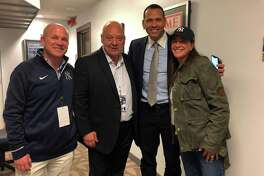 Greenwich residents Peter St. Phillip, the YES Network's John (Flip) Filippelli and Caren St. Phillip, owner of Caren's Cos Cobber, pose with New York Yankee great Alex Rodriguez at Yankee Stadium last week.