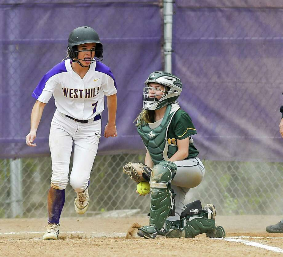 Westhill's Olivia Butler scores on a Trinity Catholic infield error in the bottom of the fourth inning on Thursday. Westhill defeated Trinity Catholic 13-5. Photo: Matthew Brown / Hearst Connecticut Media / Stamford Advocate