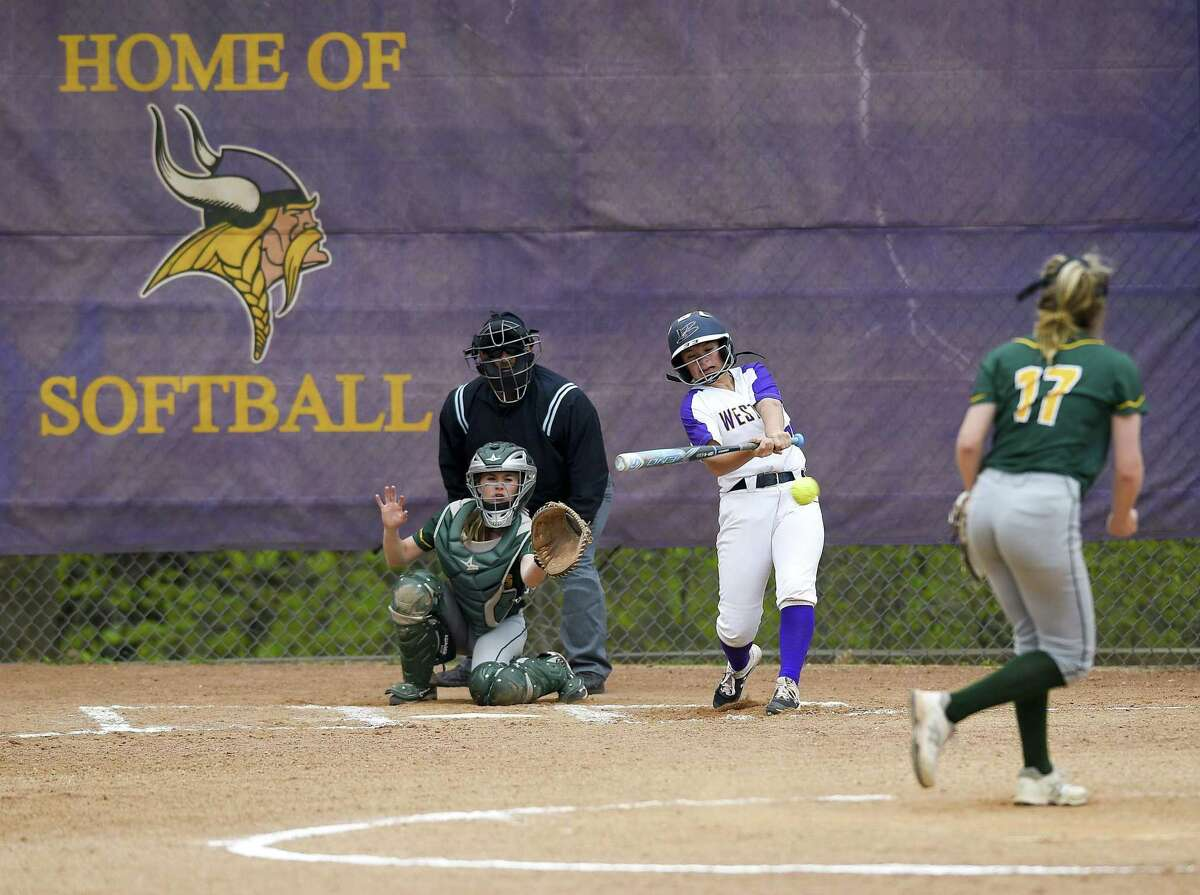 Westhill's Kirsten Hallinan hits an RBI double against Trinity Catholic in the third inning on Thursday.
