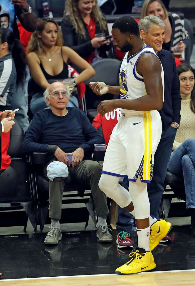 82da10893c9f Larry David looks at Golden State Warriors  Draymond Green before Warriors  play Los Angeles Clippers