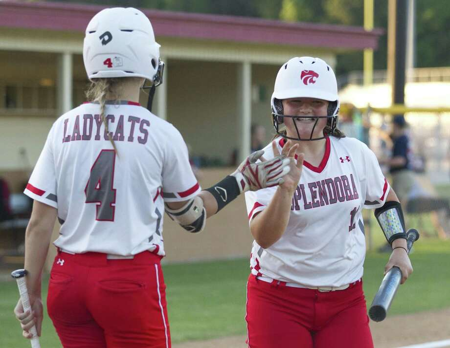 Leah Hensarling of Splendora gets a high-five from Shaelyn Sanders after scoring a run in the third inning against Hardin-Jefferson on Friday. Photo: Jason Fochtman, Houston Chronicle / Staff Photographer / © 2019 Houston Chronicle
