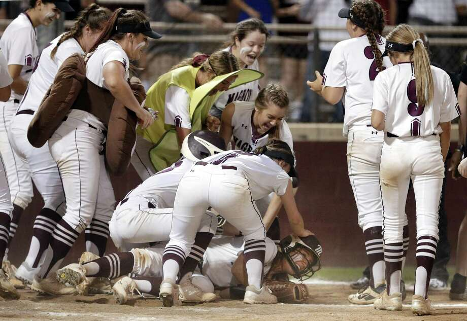Magnolia's Alex Dubose is swarmed by her teammates after her game-winning home run. Photo: Michael Wyke, Houston Chronicle / Contributor / © 2019 Houston Chronicle