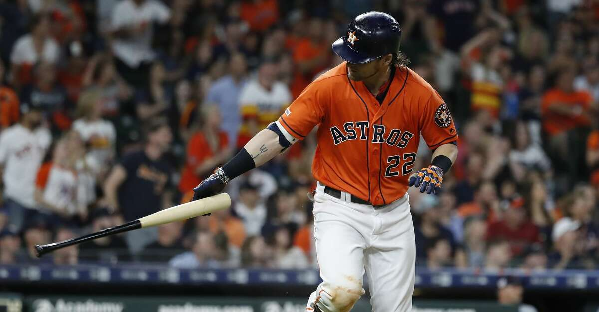 Houston Astros Josh Reddick (22) reacts after lining out to end the seventh inning of an MLB baseball game at Minute Maid Park, in Houston, Friday, April 26, 2019.