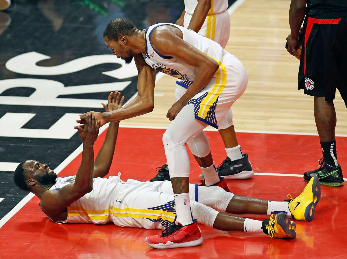 Golden State Warriors' Kevin Durant reacts after Draymond Green drew an offensive foul against Los Angeles Clippers in 2nd quarter during Game 6 of NBA Western Conference first round playoffs at Staples Center in Los Angeles, Calif., on Friday, April 26, 2019.