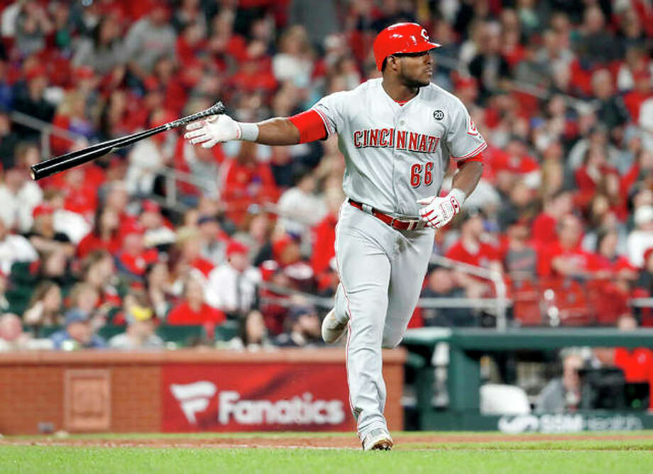 The Reds' Yasiel Puig tosses aside his bat as he watches his two-run home run in the eighth inning of Friday night's game against the Cardinals in St. Louis. Photo: Jeff Roberson | AP Photo