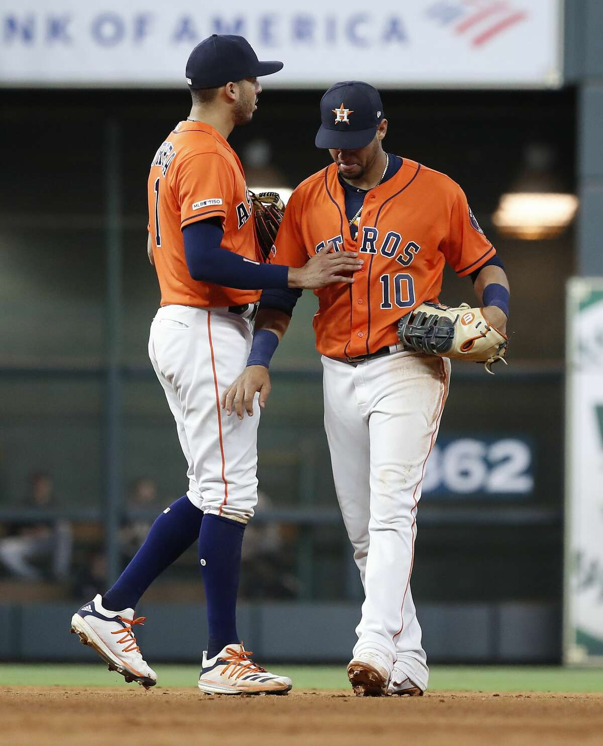 Houston Astros shortstop Carlos Correa (1) reasures Yuli Gurriel (10) after he tried to field a sharply hit line drive by Cleveland Indians Carlos Gonzalez during the eighth inning of an MLB baseball game at Minute Maid Park, in Houston, Friday, April 26, 2019.