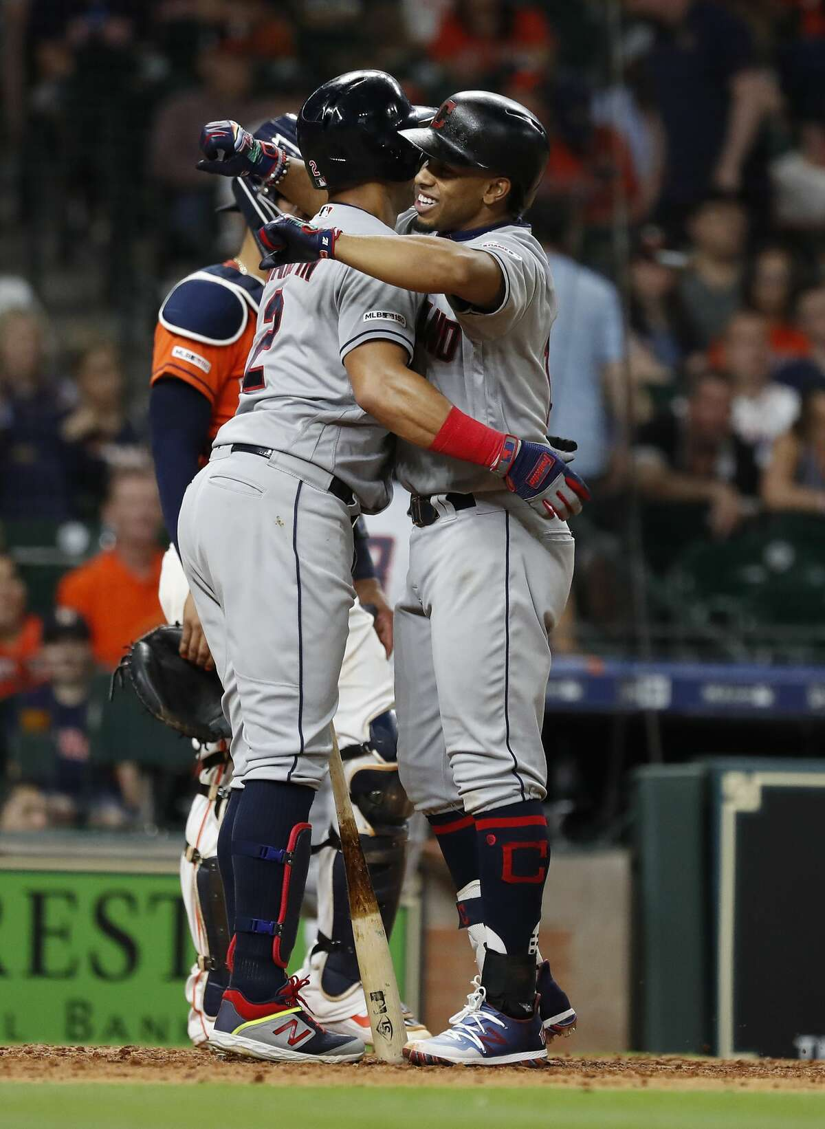 Cleveland Indians Francisco Lindor (12) hugs Leonys Martin (2) after Lindor's second home run of the night during the ninth inning of an MLB baseball game at Minute Maid Park, in Houston, Friday, April 26, 2019.