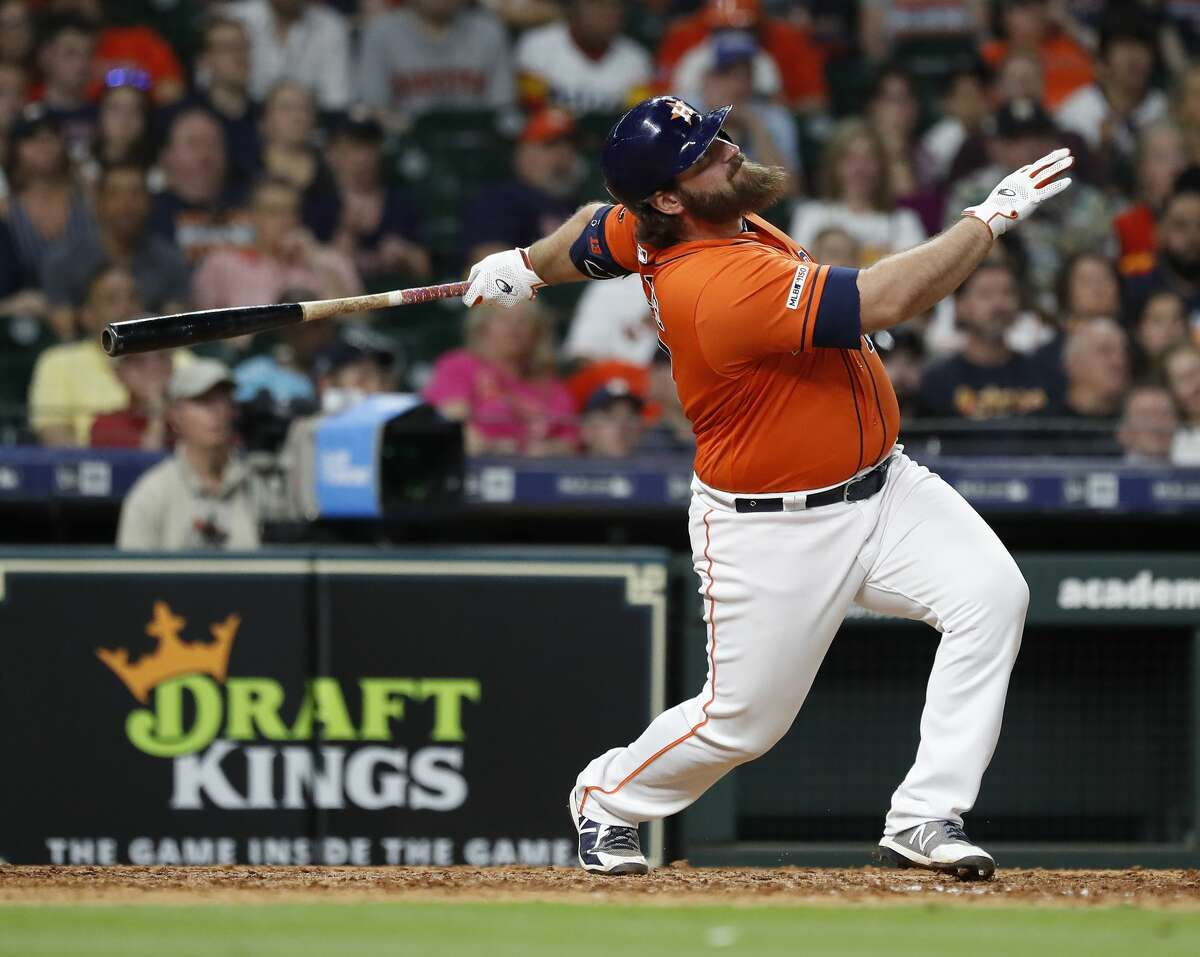 Houston Astros Tyler White (13) flies out during the eighth inning of an MLB baseball game at Minute Maid Park, in Houston, Friday, April 26, 2019.