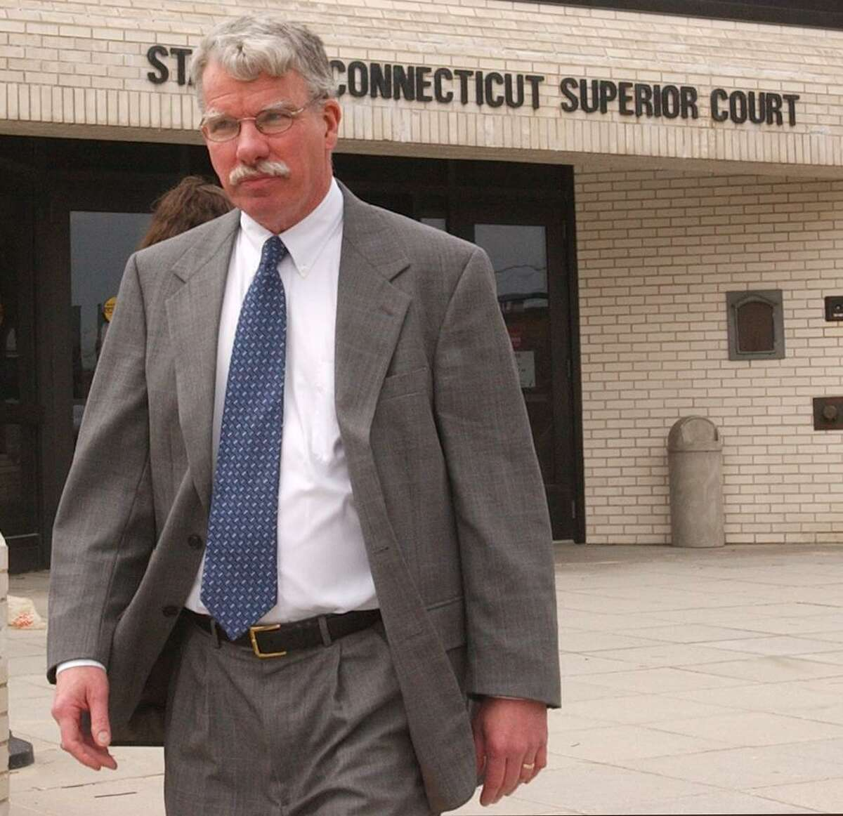 New London, Connecticut-HVIZDAK-4/7/05: New London County State Attorney Kevin Kane leaves New London Superior Court during a lunch break in the new competency hearings that began today 4/7/05 in the case of convicted serial killler Michael Ross. Kane is arguine in court that Ross is competent and should be executed. The court will ultimately decide if Ross is competent to forgo further appeals and proceed with his execution in May 2005. Photograph by Peter Hvizdak ph0300a #117 Photograph by Peter Hvizdak ph0300a #117