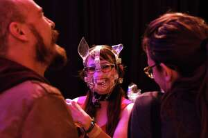 A masked bartender makes drinks on opening night of the annual Seattle Erotic Arts Festival, April 26, 2019.