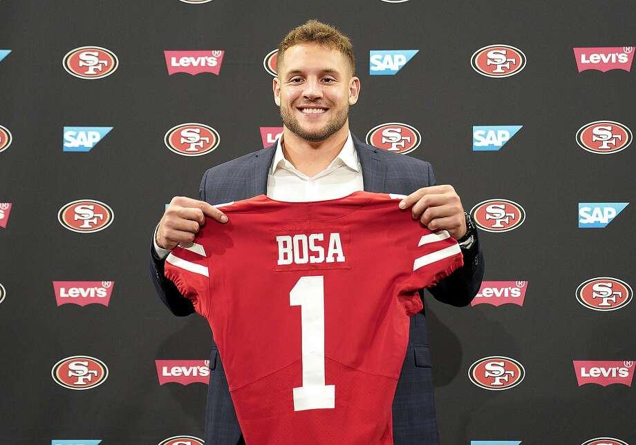 San Francisco 49ers first-round pick Nick Bosa poses with his jersey during an NFL football news conference, Friday, April 26, 2019, in Santa Clara, Calif. (AP Photo/Tony Avelar ) Photo: Tony Avelar / Associated Press