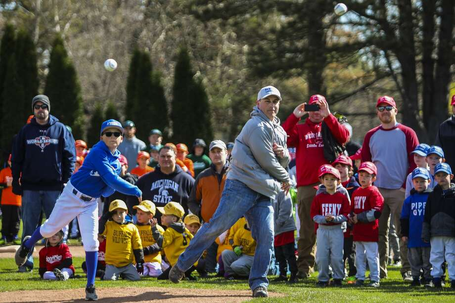 Zane Hemler, left, and Matt Hansen, right, throw out the first pitches of the season during Northeast Little League's opening day ceremony on Saturday, April 27, 2019 at Plymouth Park. (Katy Kildee/kkildee@mdn.net) Photo: (Katy Kildee/kkildee@mdn.net)
