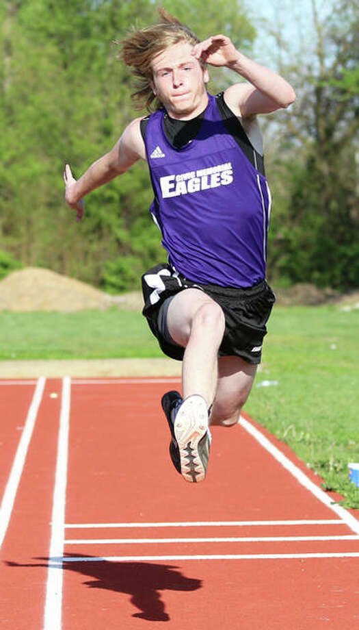 CM's Dillon Dublo competes in the triple jump Monday at the Madison County small-schools track meet at Roxana. At Staunton on Friday, Dublo won the triple to help the Eagles claim the boys title at the Staunton Relays. Photo: Greg Shashack / The Telegraph