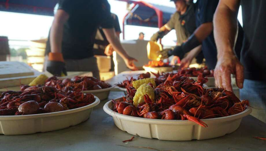 The Cajun Country Cookers crew prepare the crawfish plates at the 23rd Humble Police Association Crawfish Festival on April 26 in Humble. Photo: Nguyen Le / Staff Photo