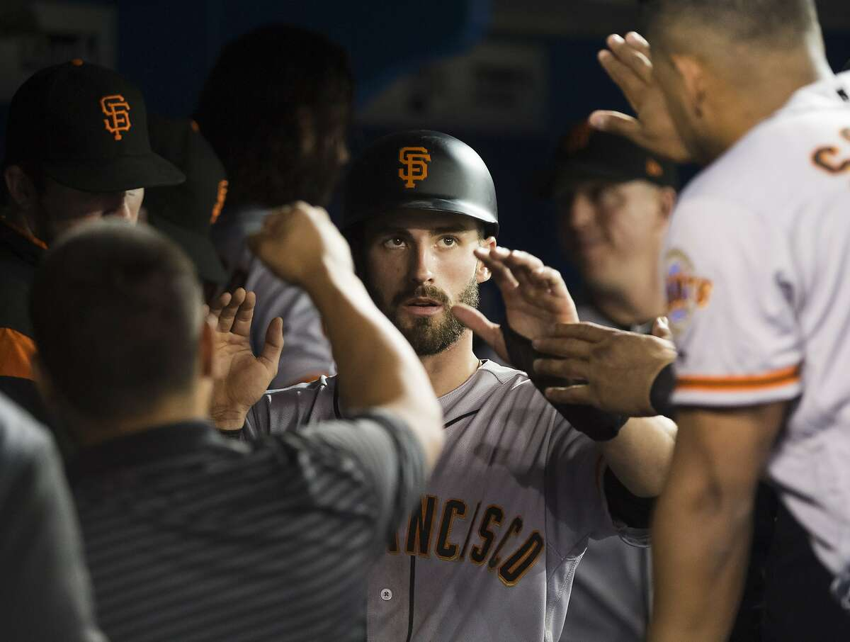 San Francisco Giants' Steven Duggar, centre, celebrates with teammates after scoring a run against the Toronto Blue Jays during fourth inning baseball action in Toronto, on Wednesday, April 24, 2019. (Nathan Denette/The Canadian Press via AP)