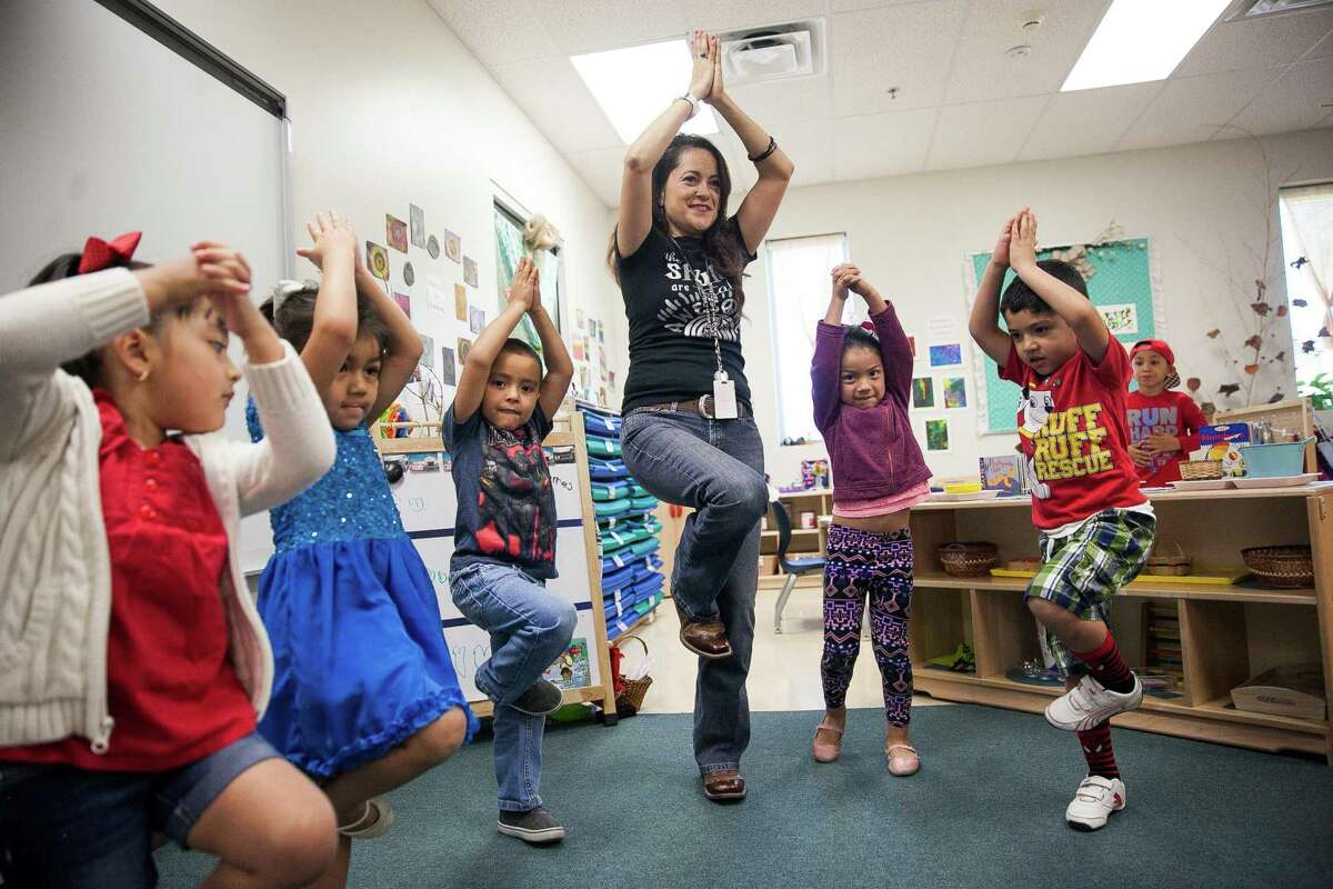 Master Teacher Marielos Romero's leads her bilingual class in a stretch that helps promote stronger balance during the movement session where the children have time to dance and move before starting their day Friday May 6, 2016 during at the Pre-K 4 SA South Education Center. This facility is one of four education centers around the city. Rep. Joaquin Castro is trying to take the concept of Pre-K for SA to a national level, targeting Los Angeles, San Francisco and Denver are three cities that are targeted.