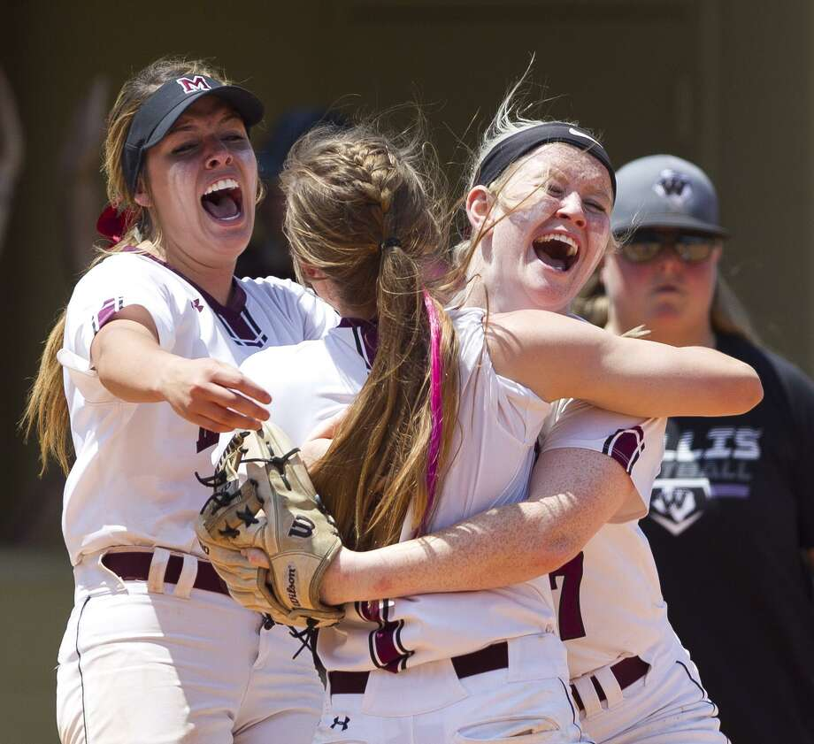 Magnolia players react after their 7-6 win over Willis in Game 3 of a Region III-5A bi-district softball playoff match, Saturday, April 27, 2019, in Conroe. Photo: Jason Fochtman, Houston Chronicle / Staff Photographer / © 2019 Houston Chronicle