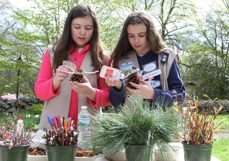 Lauren Rutkoske and Sophia Fryer, both of Greenwich and members of Girl Scout Troop 50247 craft Tree Herb Fairy's during the annual Arbor Earth Festival at the Bartlett Arboretum and Gardens on April 27, 2019 in Stamford. Several hundred visitors enjoyed Tree Climbing Demos, Face Painting, Sun Catcher and other Arbor Day games, Roaming Musicians and several educational exhibits and workshops. Photo: Matthew Brown / Hearst Connecticut Media / Stamford Advocate