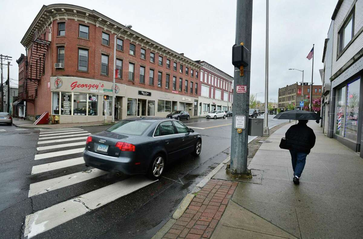 A stretch of storefronts in April 2019 on Wall Street in Norwalk, Conn. At year end, the city unveiled a new program of grants to underwrite the cost of facade improvements for stores throughout Norwalk.