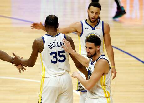 Golden State Warriors' Kevin Durant is greeted by Stephen Curry and Klay Thompson after scoring his 50th point of the game during Warriors' 129-110 win over Los Angeles Clippers in Game 6 of NBA Western Conference first round playoffs at Staples Center in Los Angeles, Calif., on Friday, April 26, 2019.
