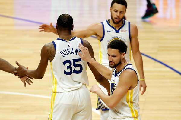 e49e3d0e3e6 3of4Golden State Warriors  Kevin Durant is greeted by Stephen Curry and  Klay Thompson after scoring his 50th point of the game during Warriors   129-110 win ...