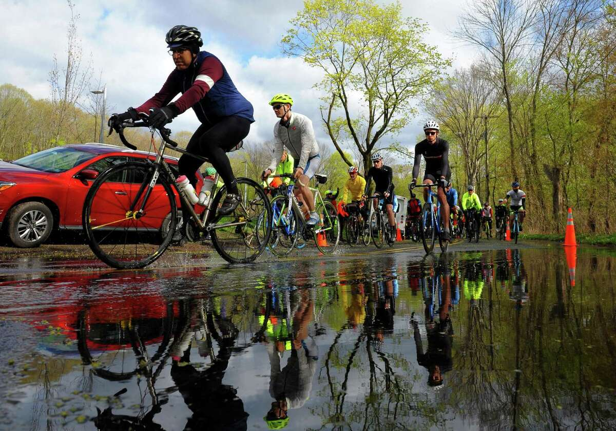 Elite riders take off from the Common Ground High School grounds on a 65.5 mile ride for the Rock to Rock Earth Day Ride in New Haven, Conn., on Saturday April 27, 2019.