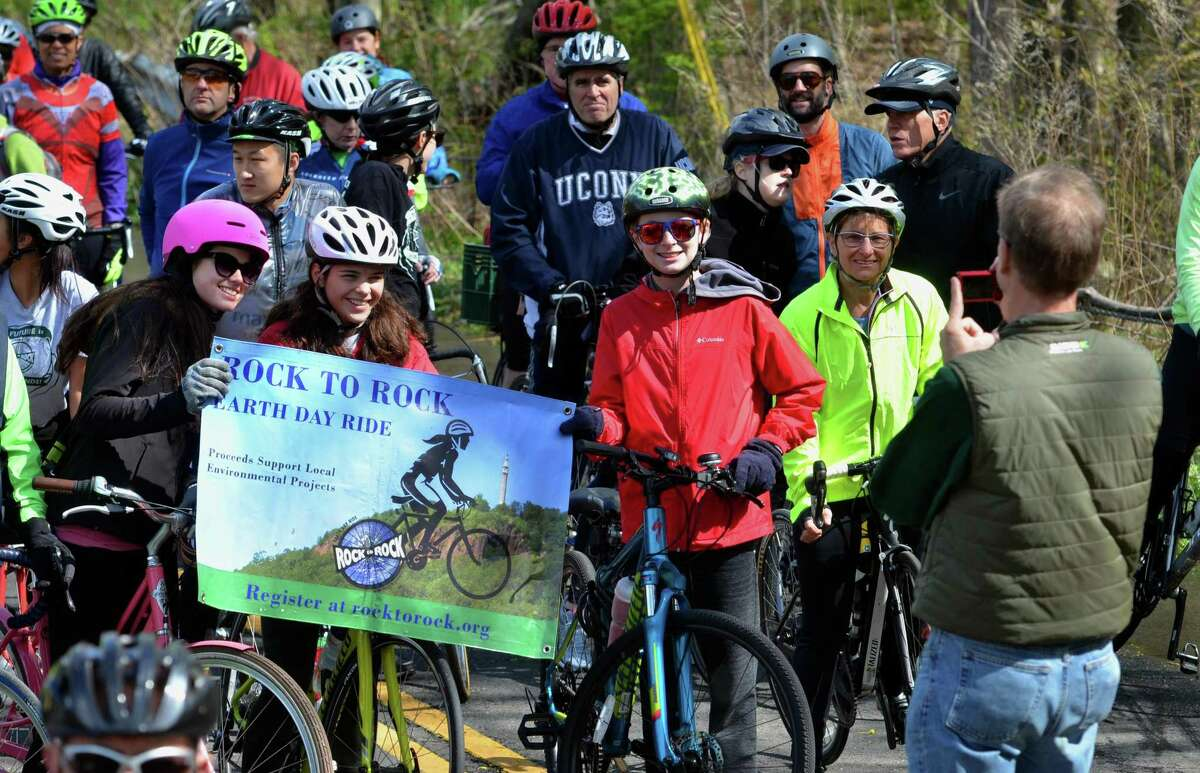 Riders pose for photos at the starting line at the Common Ground High School grounds before the start of the 12 mile ride for the Rock to Rock Earth Day Ride in New Haven, Conn., on Saturday April 27, 2019.