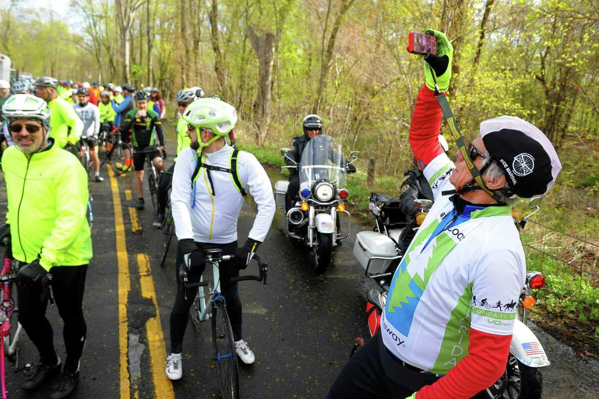 Elite rider Rob Dexter, of West Hartford, snaps pictures of his fellow riders at the starting line before they take off for a 65.5 mile ride for the Rock to Rock Earth Day Ride from the Common Ground High School grounds in New Haven, Conn., on Saturday April 27, 2019. In 2018, 1,300 riders raised $227,000 for 34 local organizations -- a Rock to Rock record.