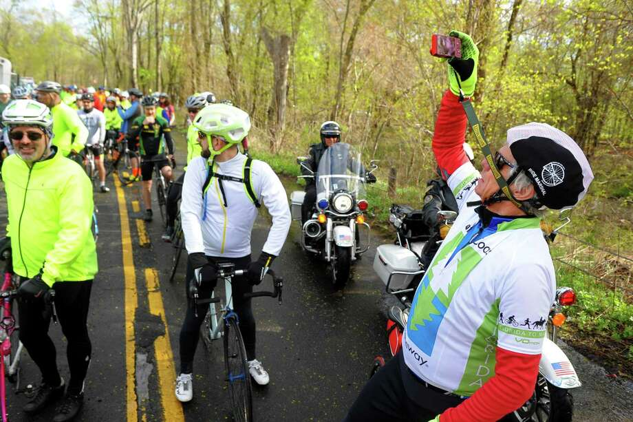 Elite rider Rob Dexter, of West Hartford, snaps pictures of his fellow riders at the starting line before they take off for a 65.5 mile ride for the Rock to Rock Earth Day Ride from the Common Ground High School grounds in New Haven, Conn., on Saturday April 27, 2019. In 2018, 1,300 riders raised $227,000 for 34 local organizations -- a Rock to Rock record. Photo: Christian Abraham / Hearst Connecticut Media / Connecticut Post