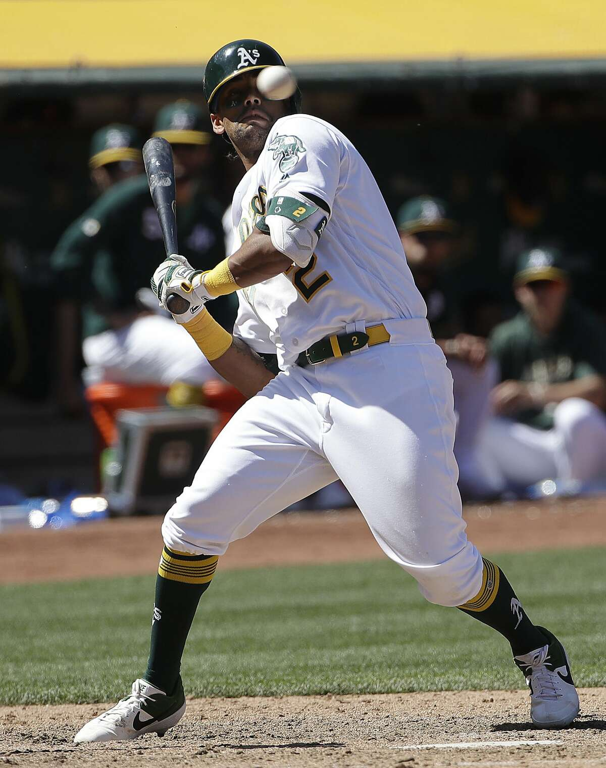 Oakland Athletics' Khris Davis leans back from a pitch against the Texas Rangers during the seventh inning of a baseball game in Oakland, Calif., Wednesday, April 24, 2019. (AP Photo/Jeff Chiu)