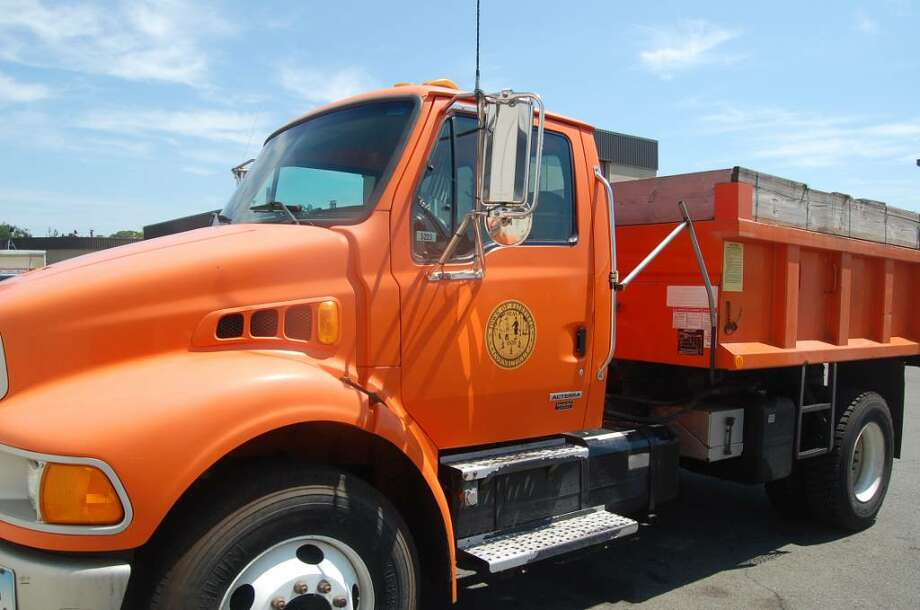 Federal funds will retrofit 39 vehicles in the Public Works Department's fleet with devices that will greatly reduce emissions of harmful pollutants. In 2005, Fairfield's school buses were equipped with similar devices. Photo: Anthony Karge / Fairfield Citizen