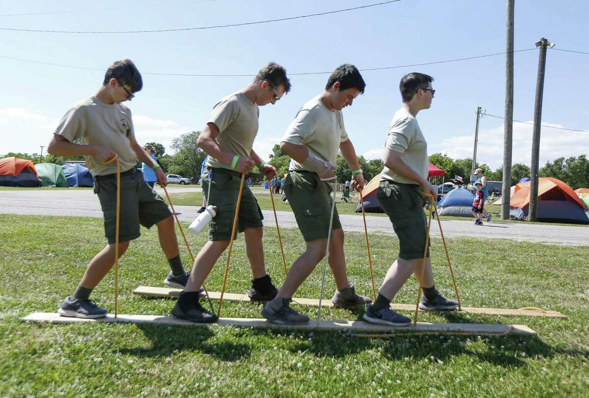 Members of Troop 615, League City, Chris Khapprott (l-r), William Smith, Alan Jones and Logan Mooty work together on the Board Walk during the Scout-O-Rama Saturday, April 27, 2019, in Angleton.