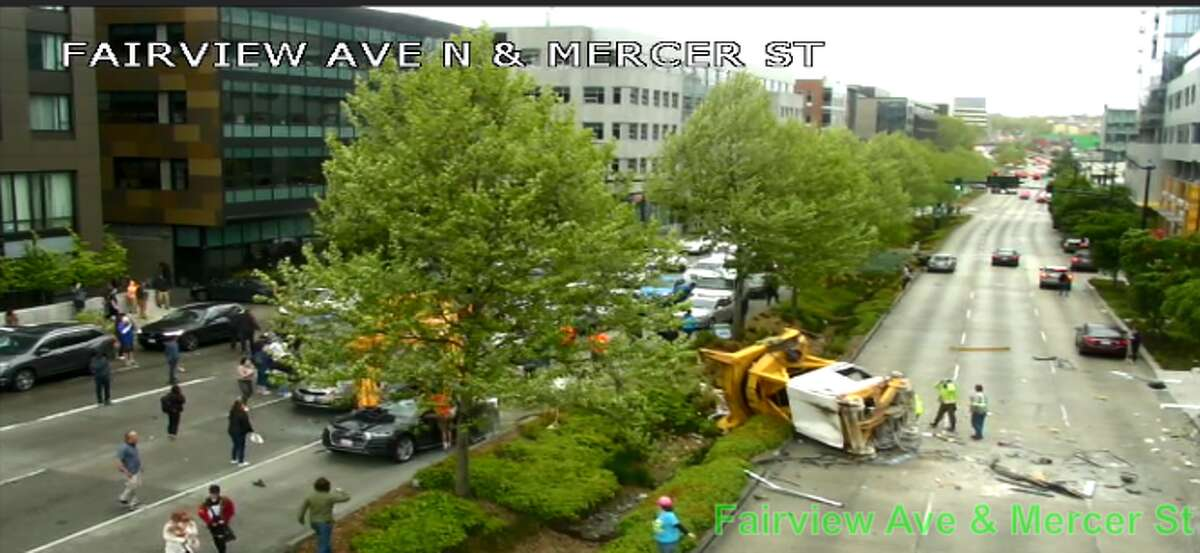 A crane fell on multiple cars on Mercer Street on April 27, snarling traffic and closing lanes and Interstate 5 ramps.