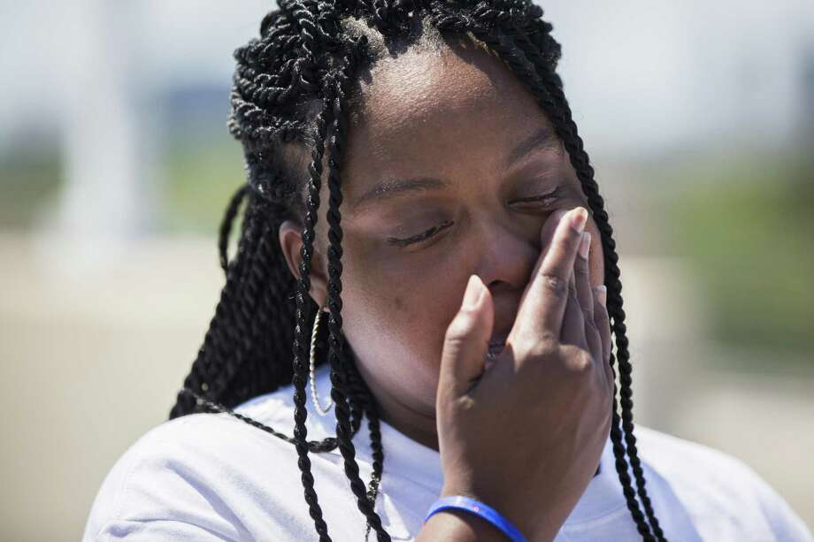 Yentl Brooks, 33, gets emotional during a Missing in Harris County Day butterfly release ceremony on Saturday, April 27, 2019, in Houston. Brooks' aunt Veronda Kay Sanders, 61, has been missing since October 17th, 2018. Photo: Marie D. De Jesús, Houston Chronicle / Staff Photographer / © 2019 Houston Chronicle