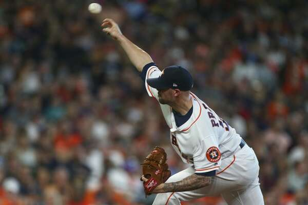 Houston Astros relief pitcher Ryan Pressly (55) throws the ball against the Cleveland Indians during the seventh inning of an MLB game at Minute Maid Park Saturday, April 27, 2019, in Houston.